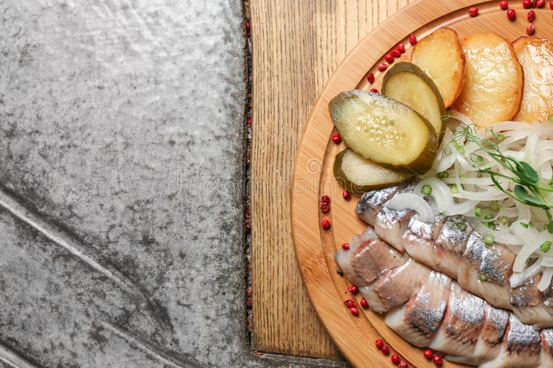 Tasty herring with potato, onion and pickles on table royalty free stock photos