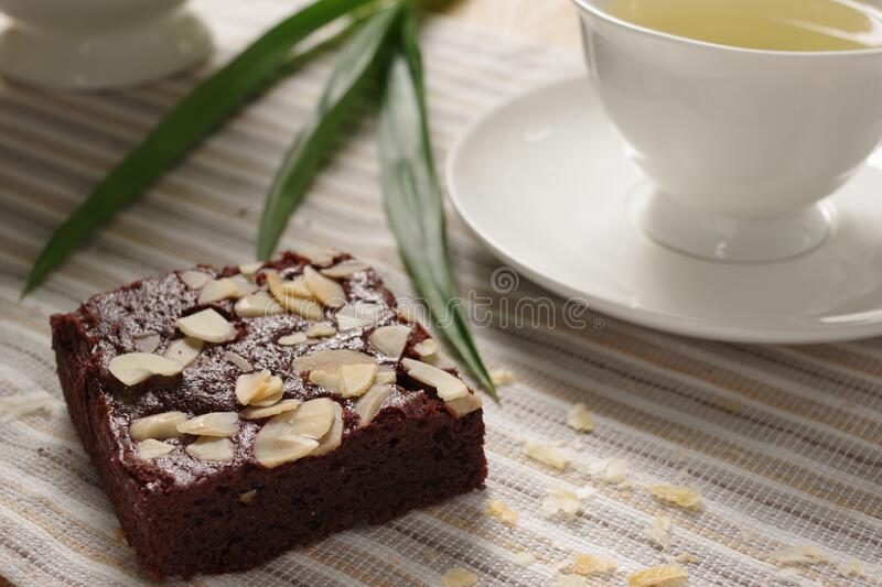 Tasty homemade brownie with earl grey in the afternoon tea. royalty free stock images
