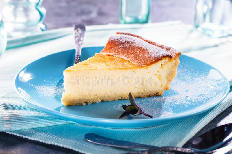 Tasty homemade cheesecake on blue wooden table. Selective focus. royalty free stock photos