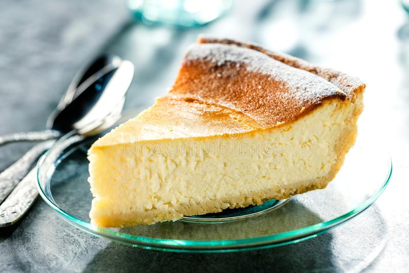 Tasty homemade cheesecake on blue wooden table. Selective focus. royalty free stock images