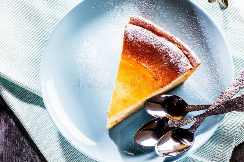 Tasty homemade cheesecake on blue wooden table. Selective focus. royalty free stock photography