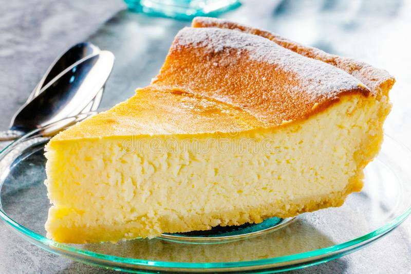 Tasty homemade cheesecake on blue wooden table. Selective focus. stock photo