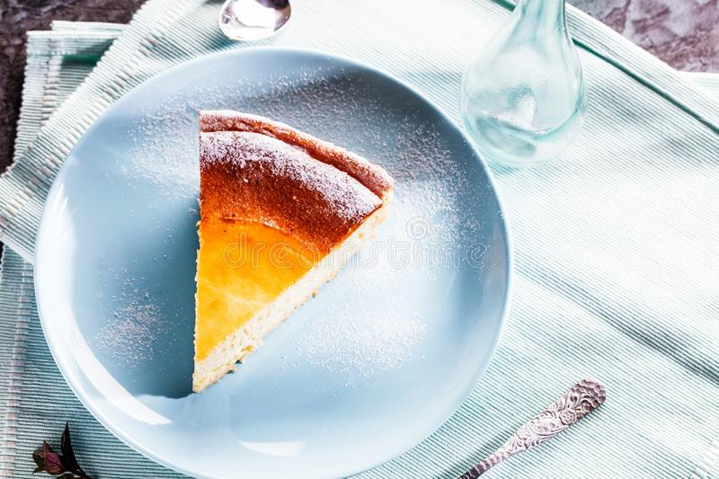 Tasty homemade cheesecake on blue wooden table. Selective focus. stock images