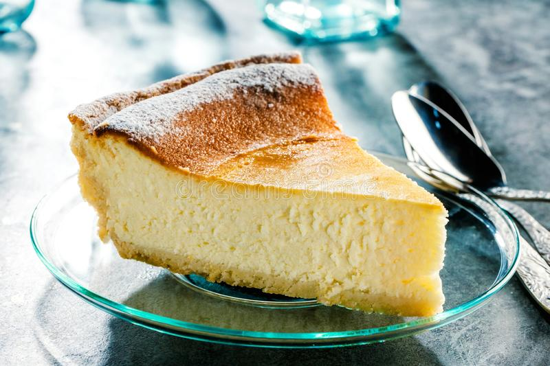 Tasty homemade cheesecake on blue wooden table. Selective focus. royalty free stock image
