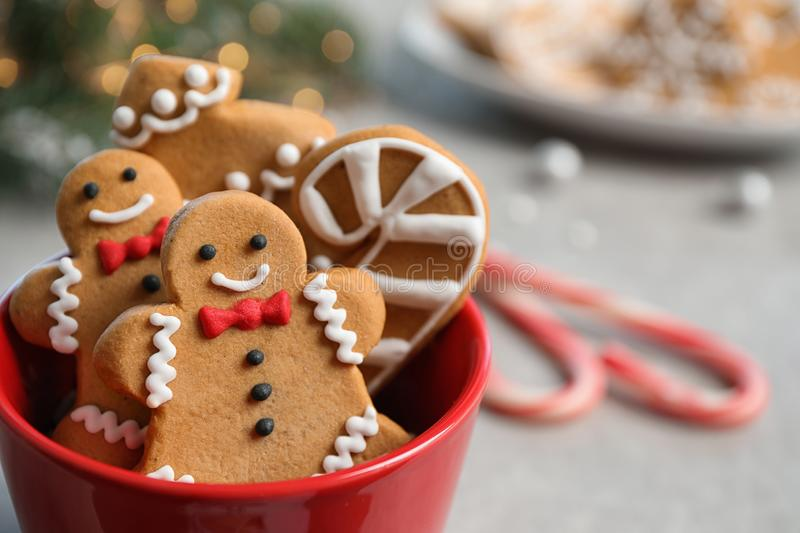 Tasty homemade Christmas cookies in cup on grey table. Closeup view royalty free stock photo