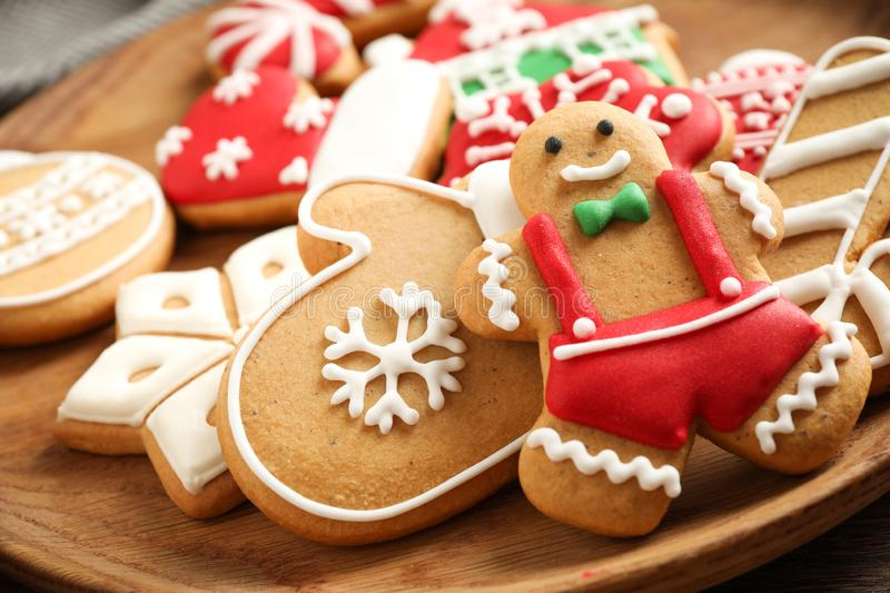Tasty homemade Christmas cookies on wooden plate. Closeup view royalty free stock images