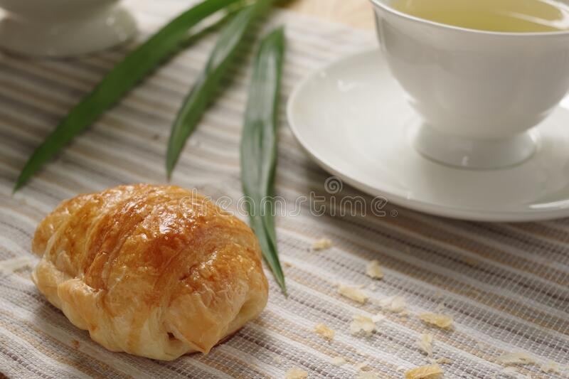 Tasty homemade croissant with earl grey in the afternoon tea. stock photo