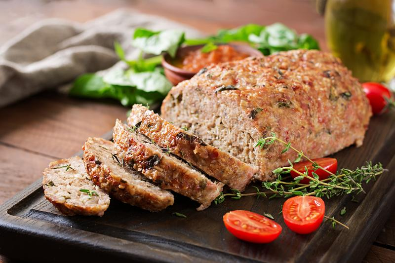 Tasty homemade ground baked turkey meatloaf on wooden table. royalty free stock photos