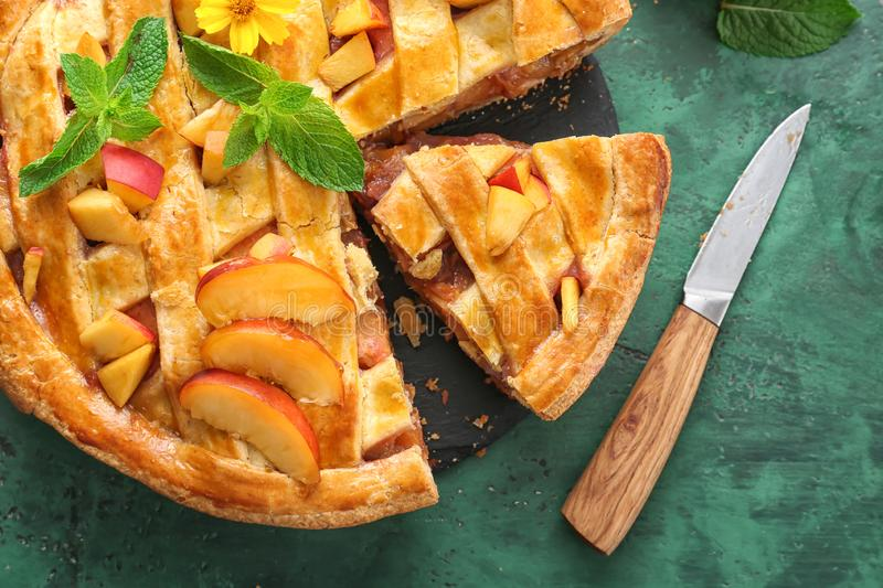 Tasty homemade peach pie on table, closeup stock images