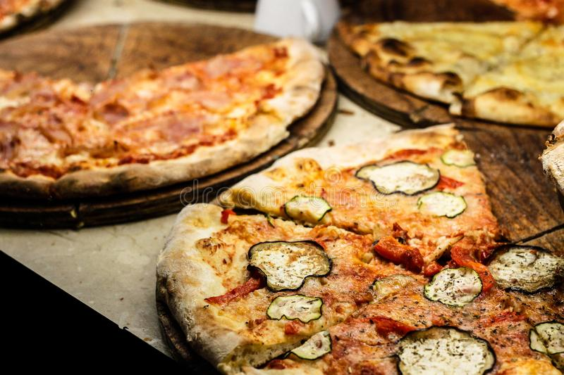 Tasty homemade pizza on a vintage wooden table stock photos