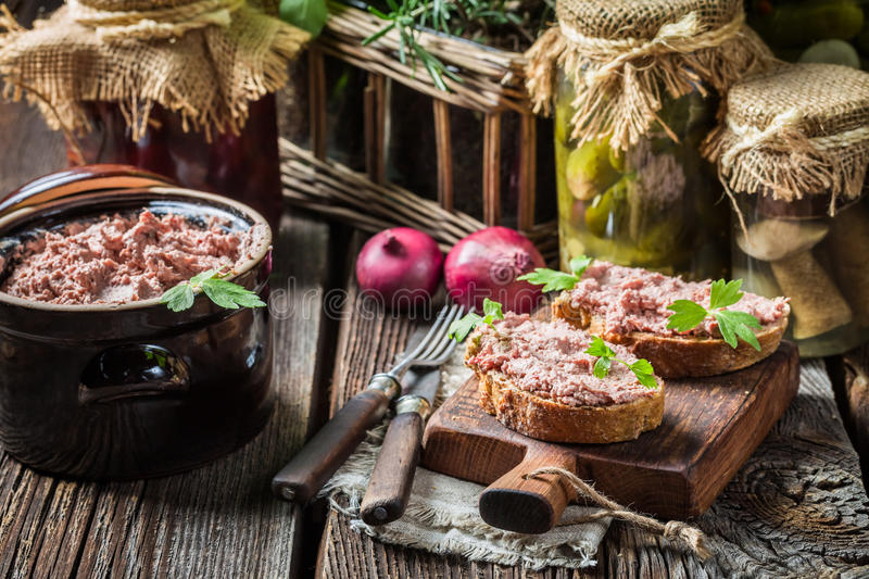 Tasty homemade sandwich with pate and parsley. On old table royalty free stock images