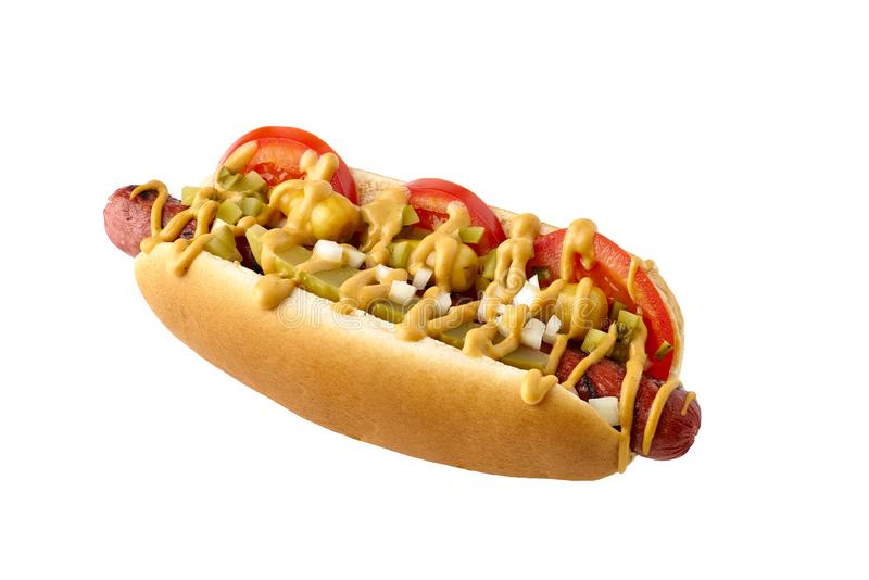 Tasty hot dog with tomatoes and pickled relish on white. Tasty hot dog with tomatoes and pickled relish isolated on white background. Clipping path included stock photography