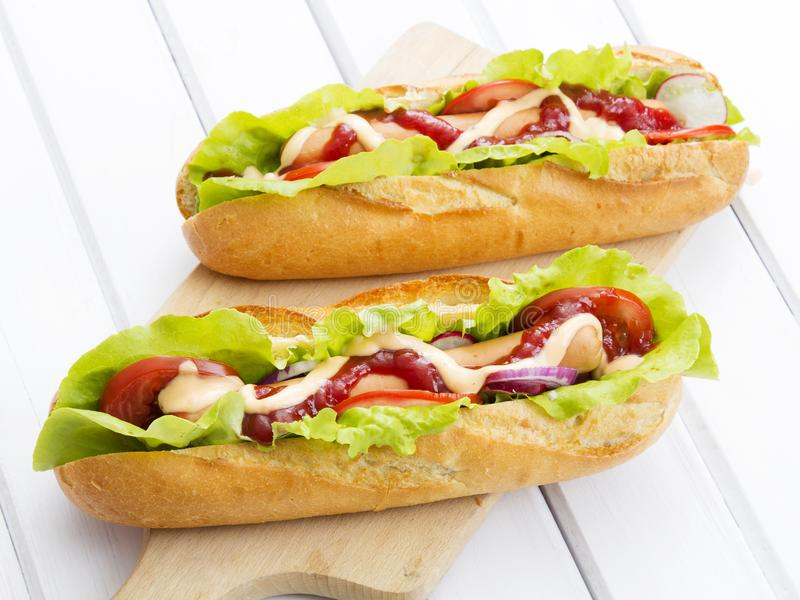 Tasty hot dogs on a wooden table. Copy space royalty free stock image