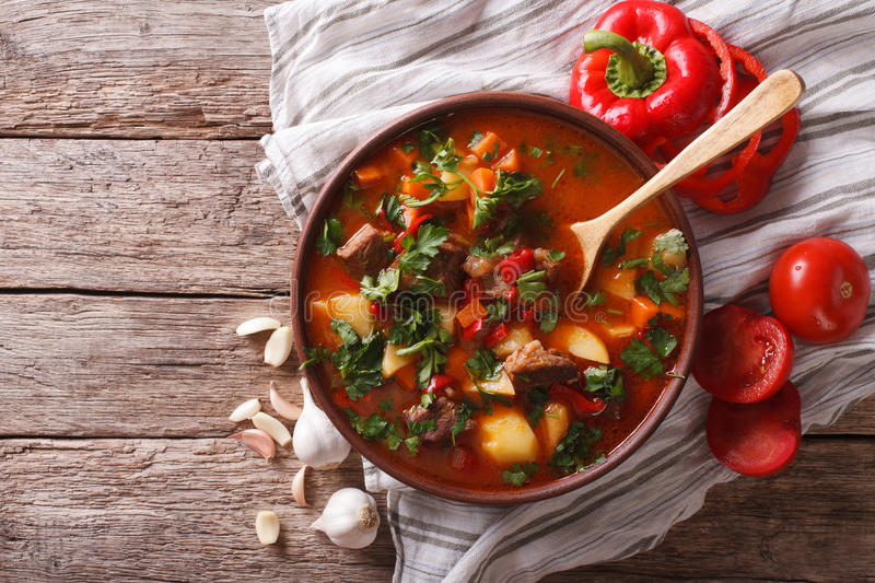 Tasty Hungarian goulash soup bograch and ingredients. horizontal stock photography