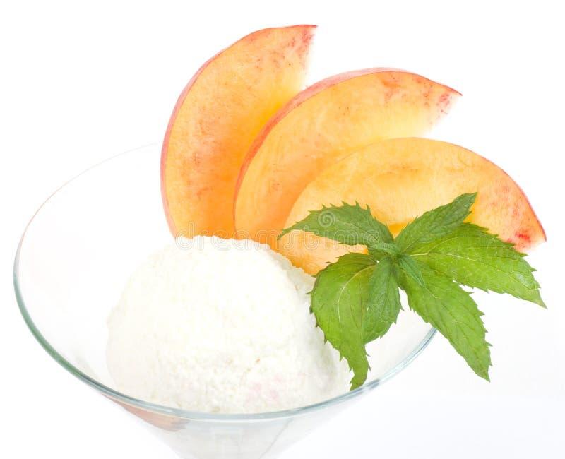 Tasty Ice Cream Dessert With Peach Royalty Free Stock Photo