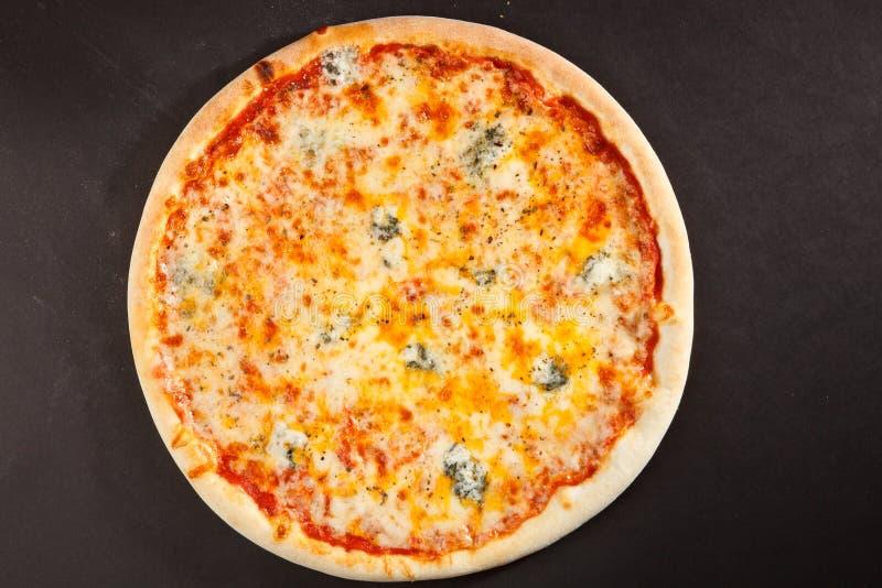 Tasty Italian pizza four kinds of cheese royalty free stock photos