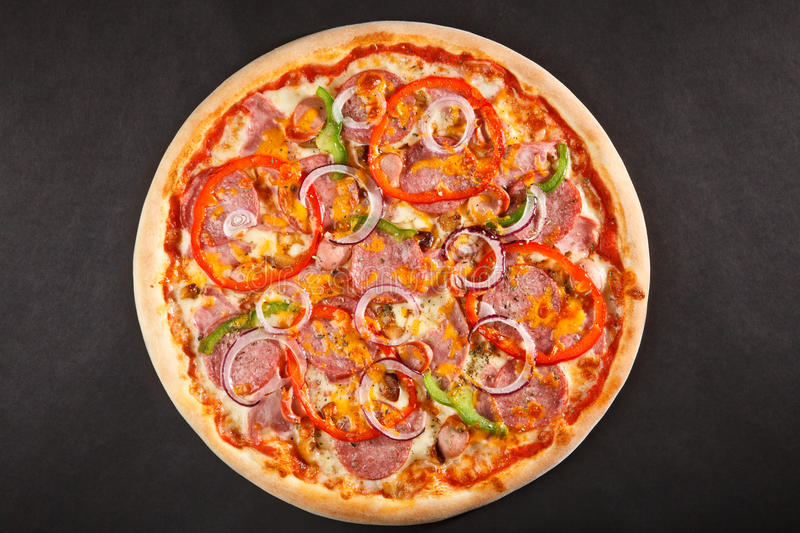 Tasty Italian pizza with pepper onion salami stock images