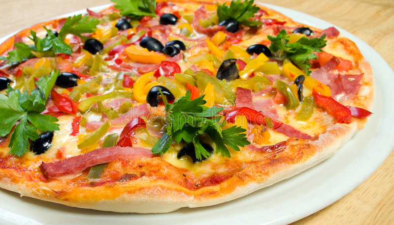 Tasty Italian pizza shallow DOF stock photography