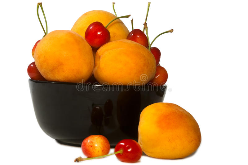 Tasty juicy peaches and cherry Isolated stock images