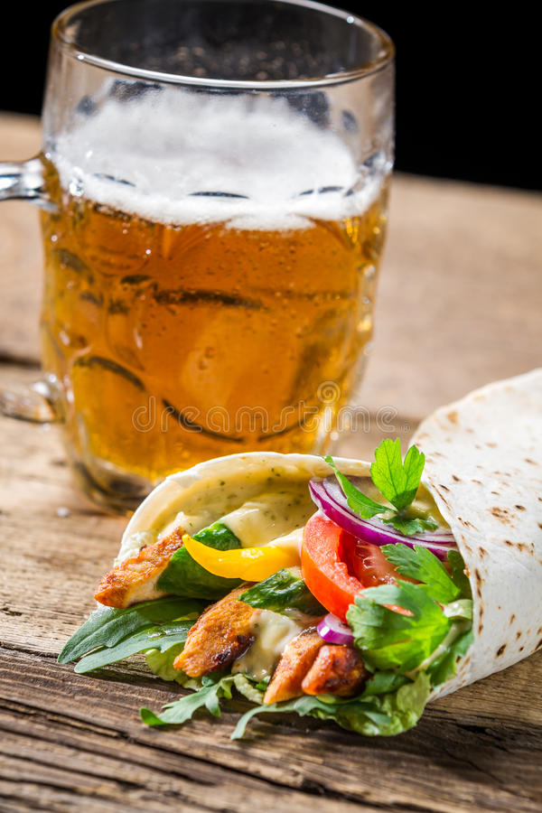 Tasty kebabs and cold beer stock photos