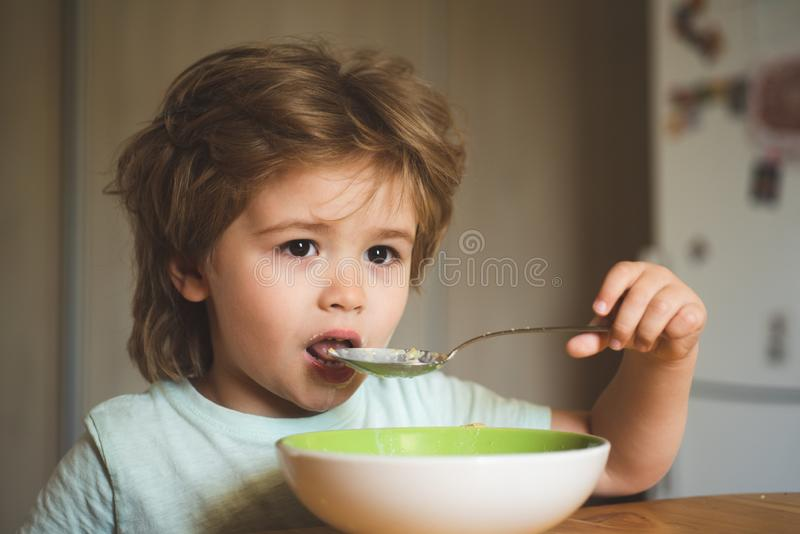 Tasty kids breakfast. Cute child eating breakfast at home. Baby eating. Good morning in Happy family. Hungry little boy royalty free stock image