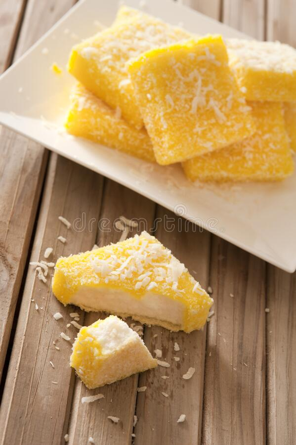 Tasty lemon lamingtons in close up view royalty free stock photo