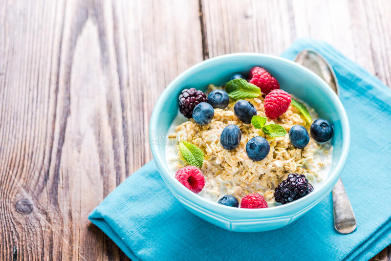 Tasty and light diet cereal breakfast with sumer fruits, wellbeing concept. royalty free stock photography