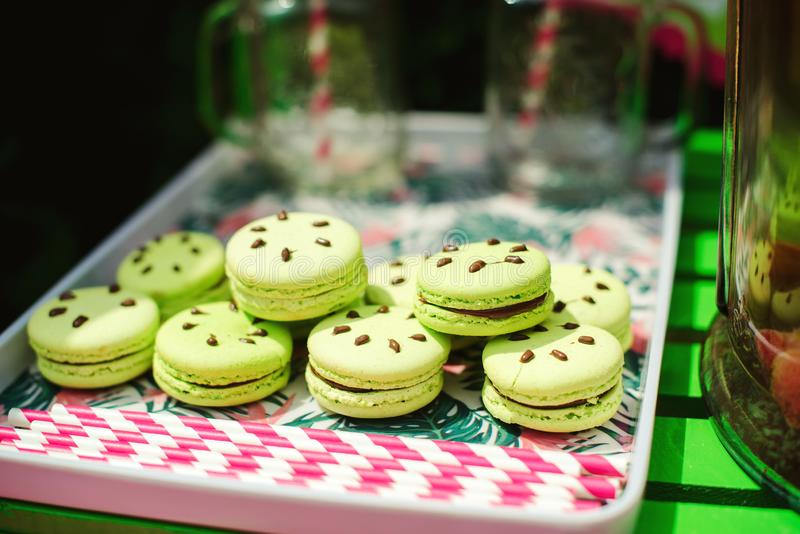 Tasty macaroons at sweet table outdoors. Summer party at backyard. Happy birthday concept royalty free stock photo