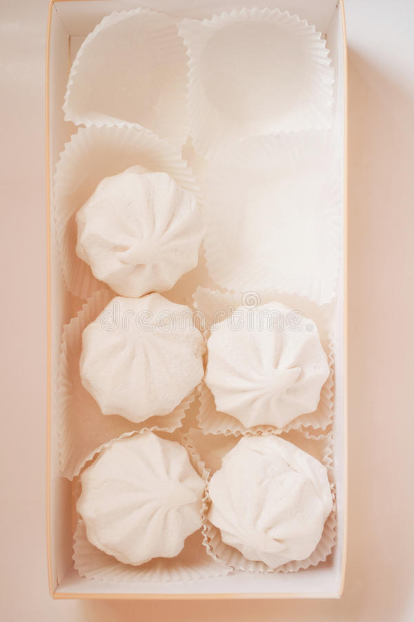 Tasty marshmallows in a box stock images