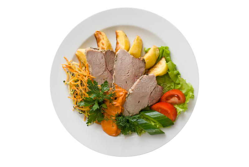 Tasty meat dish. With vegetables on white background royalty free stock photography