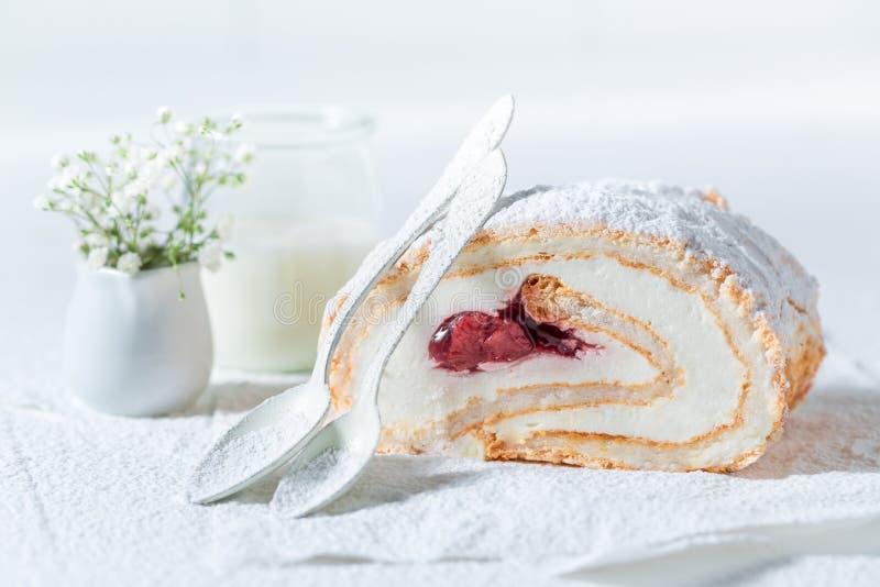Tasty meringue cake made of fresh strawberry. On white background royalty free stock image