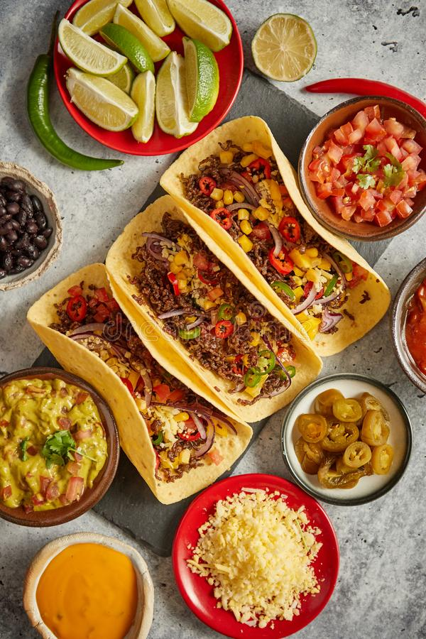 Tasty Mexican meat tacos served with various vegetables and salsa stock photo