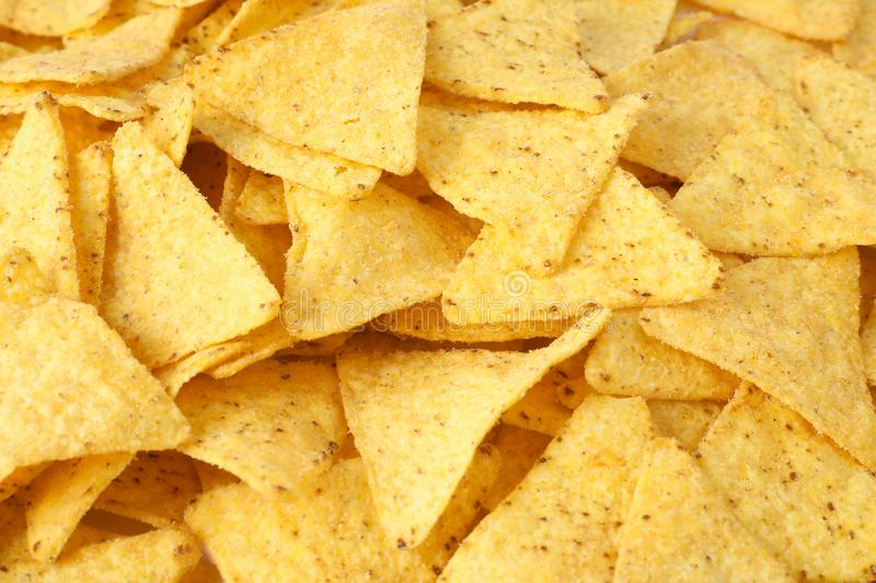Tasty Mexican nachos chips as background. Closeup royalty free stock images