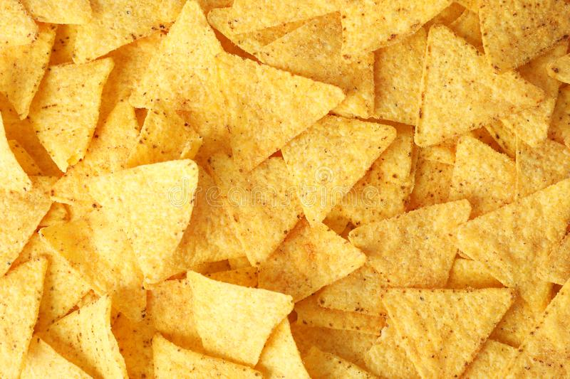 Tasty Mexican nachos chips as background. Top view royalty free stock photos