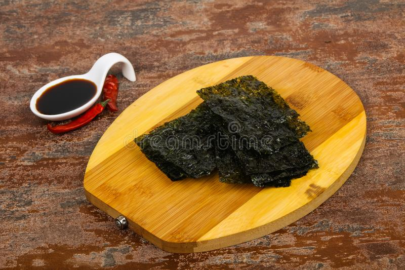 Tasty Nori chips. With soya sauce royalty free stock photos