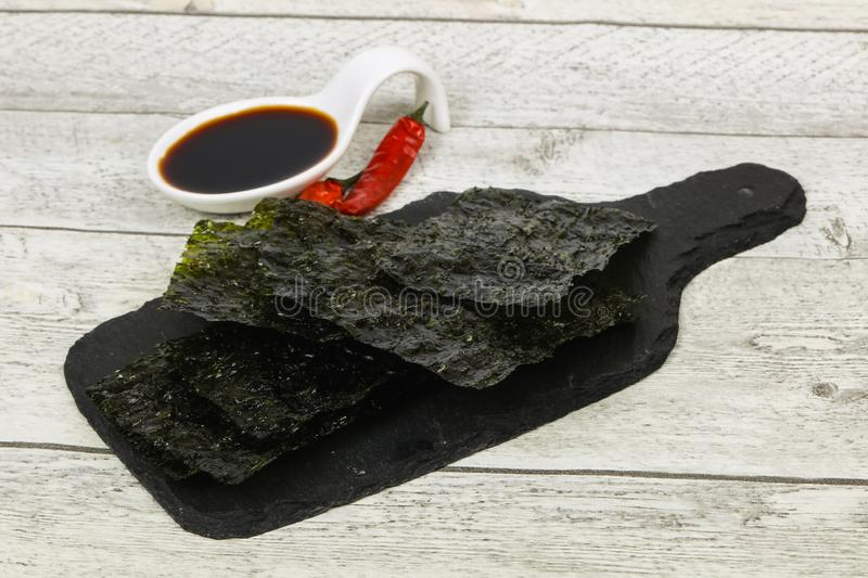Tasty Nori chips. With soya sauce stock photos