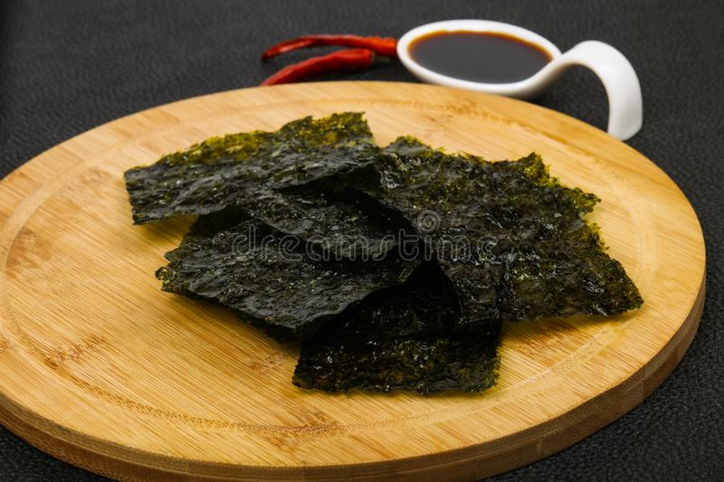 Tasty Nori chips. With soya sauce royalty free stock image