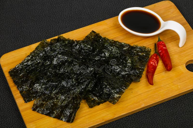 Tasty Nori chips. With soya sauce stock photography