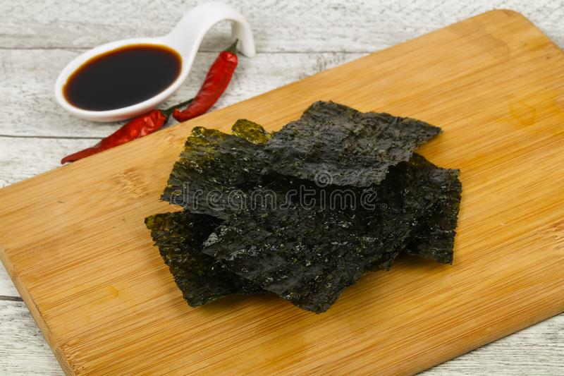 Tasty Nori chips. With soya sauce royalty free stock images