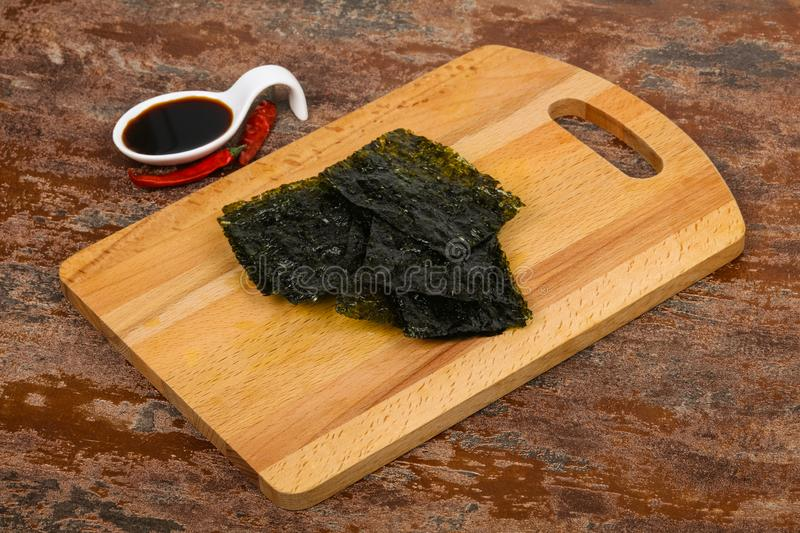 Tasty Nori chips. With soya sauce stock images