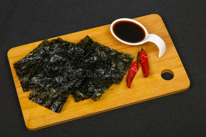 Tasty Nori chips. With soya sauce stock image