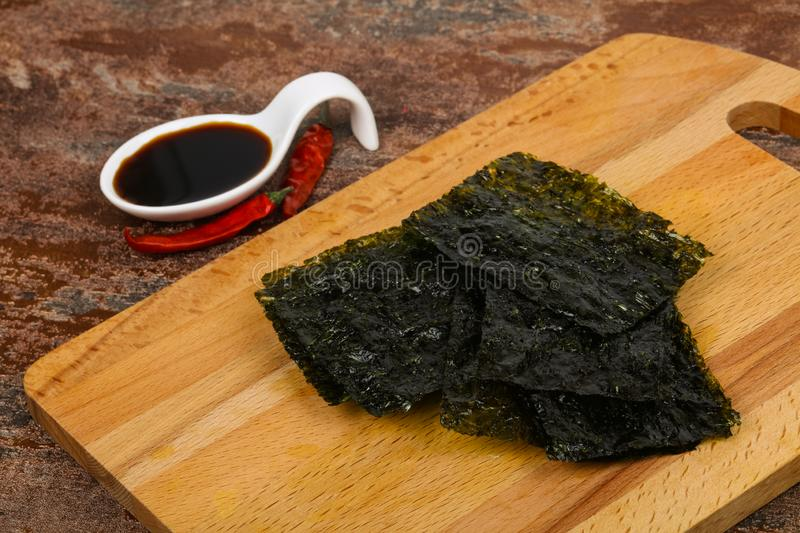 Tasty Nori chips. With soya sauce royalty free stock photo
