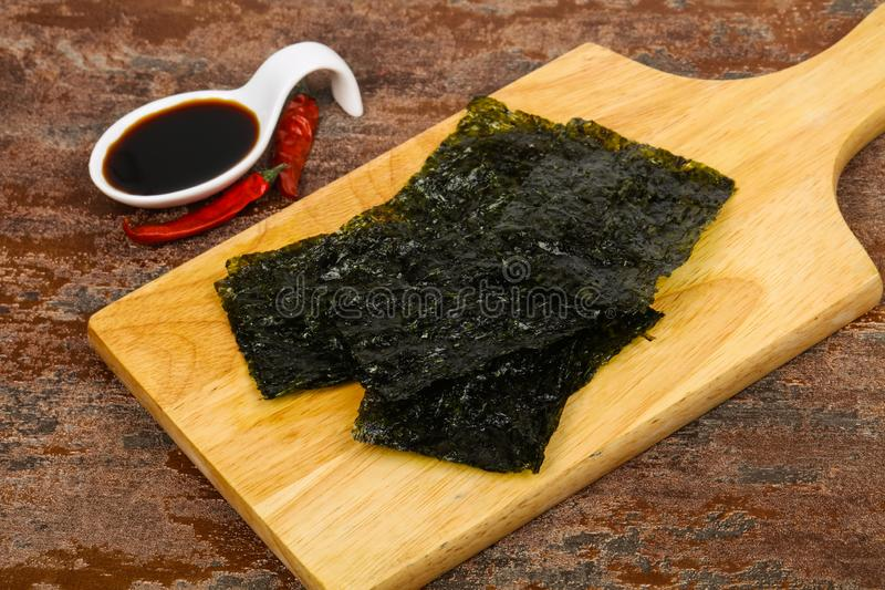 Tasty Nori chips. With soya sauce stock photo
