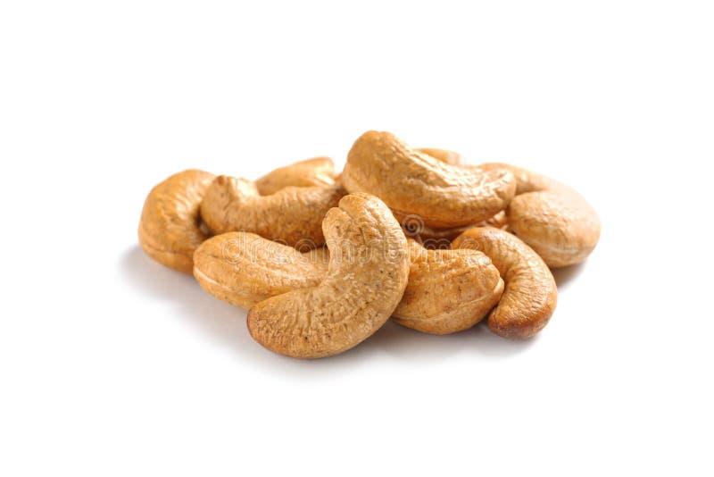 Tasty organic cashew nuts isolated on white. Backdround stock image