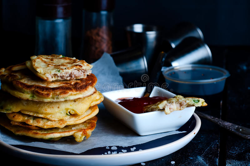 Tasty pancakes served in the plate. With tomato sous royalty free stock image