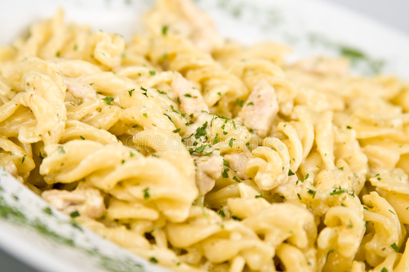 Tasty pasta with chicken, cheese and parsley 2 stock photos