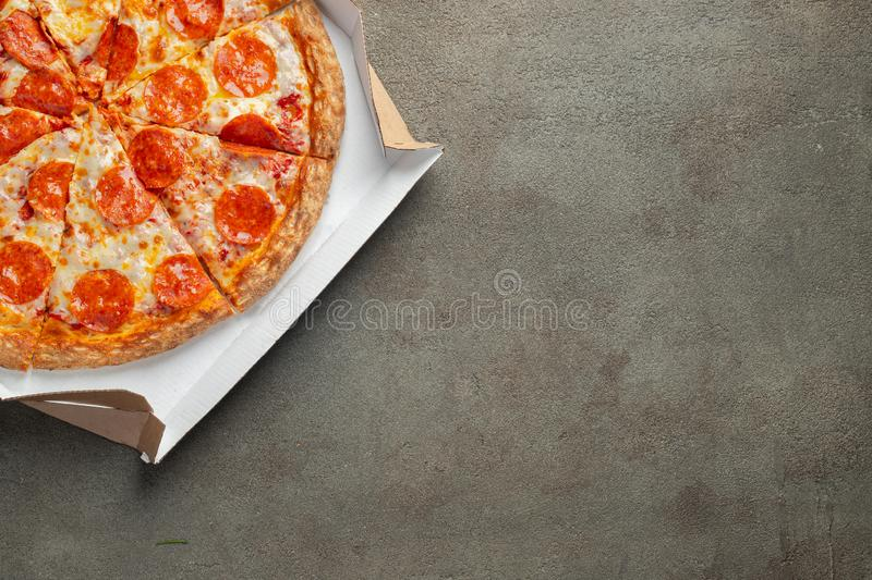 Tasty pepperoni pizza in a box. Top view stock photos