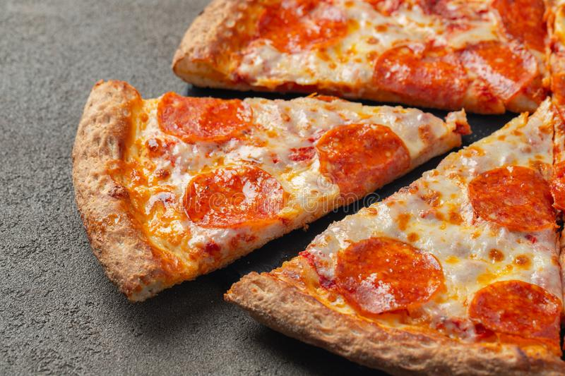 Tasty pepperoni pizza on brown concrete background royalty free stock photos