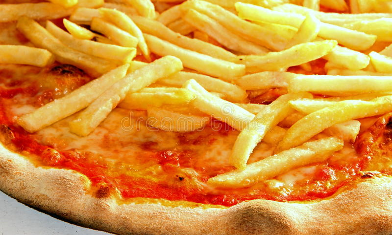 Tasty pizza with French fries stock photography