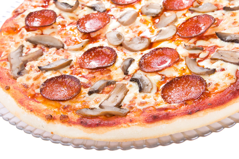 A tasty pizza with mushrooms royalty free stock image
